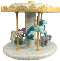 Gargoyle Carousel by S. Kay and Gerry Burnett, Encaustic on paperclay, wood, wire, paper, and gesso, 18 in x 18 in x 18 in